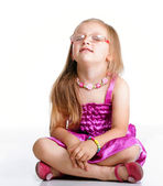 Little girl sitting on floor closed eyes isolated — Stock Photo