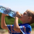 Child drinking pure water in nature — Stock Photo