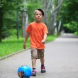 Boy kicks the ball in park outdoors — Stock Photo