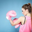 Female boxer model with big fun pink gloves — Stock Photo