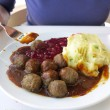 Food being eaten. Dinner meatballs with potatoes. — Stock Photo #27845991