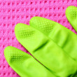 Stock Photo: Pink sponge and green rubber glove