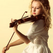 The blonde girl with a violin outdoor — Stock Photo #28133687