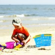 Boy playing toys on beach — Stock Photo #28179623