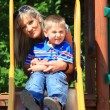 Mother and son together at the playground — Stock Photo #28255049