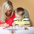 Mother and son drawing together — Stock Photo #28440507