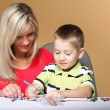 Mother and son drawing together — Stock Photo #28440531