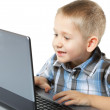 Computer addiction child with laptop notebook — Stock Photo