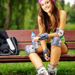 Woman roller skating sport activity in park — Foto Stock