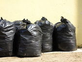 Pile of full black garbage bags — Stock Photo