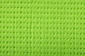 Green sponge foam as background texture — Stock Photo