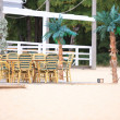 Outdoor restaurant  cafe chairs with table — Stock Photo #28654821