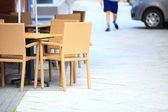 Outdoor restaurant cafe chairs with table — 图库照片