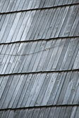 Detail of protective wooden shingle on roof — Stock Photo