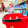 Shopping basket with grocery at supermarket — Foto Stock