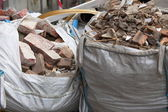 Full construction waste debris bags — Stock Photo