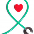 Stock Photo: Red heart and green stethoscope isolated