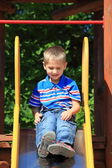 Child in playground, kid in action playing — Stock Photo