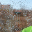 Drops on windowpane cleaning window — Stock Photo #30005677
