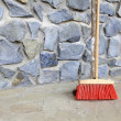 Large broom on wall outdoor - housework — Stock Photo #30006243