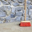 Large broom on wall outdoor - housework — Stock Photo