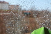 Drops on the windowpane cleaning window — Stock Photo