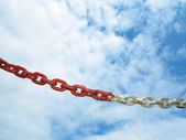 Steel metal chain links segment sky background — Stock Photo