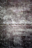 Black metal plate or armour texture with rivets — Stock Photo