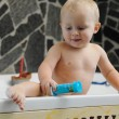 Little baby boy taking a bath playing — Stock Photo