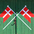 Danish flag painted on wood green door — Stock Photo