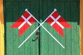 Danish flag painted on wood green door — Stock Photo