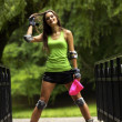 Woman roller skating sport activity in park — Stock Photo #30281927