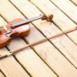Violin on wooden pier. Music concept — Stock Photo