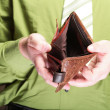 Empty wallet in male hands - poor economy — Stock Photo