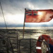 British maritime ensign flag boat and stormy sky — Stock Photo