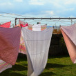Clothes hanging to dry on laundry line — Stock Photo #30473263