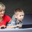 Mother with son looking on the laptop — Stock Photo