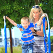 Stock Photo: Mother and son together at playground