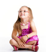Cute little girl sitting and smiling, isolated — Stockfoto