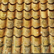 Old tiles red roof as background — Stock Photo