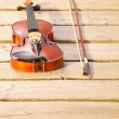 Violin on wooden pier. Music concept — Stock Photo #30617187