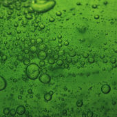 Soap bubbles green liquid background — Stock Photo