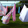 Clothes hanging to dry on laundry line — Stock Photo #30650729