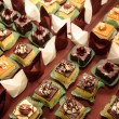 Stock Photo: Varieties of cakes desserts catering sweets