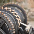 Stock Photo: Steel cog wheels metal gears mechanical ratchets