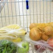 Shopping cart with grocery at supermarket — Stock Photo #30839037