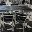 Outdoor restaurant cafe chairs with table — Stock Photo