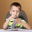 Young cute boy draws with color pencils — Stock Photo #30925931