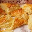 Puff cookies apple turnovers food background — Stock Photo