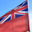 British maritime red ensign flag blue sky — Stock Photo #30937479